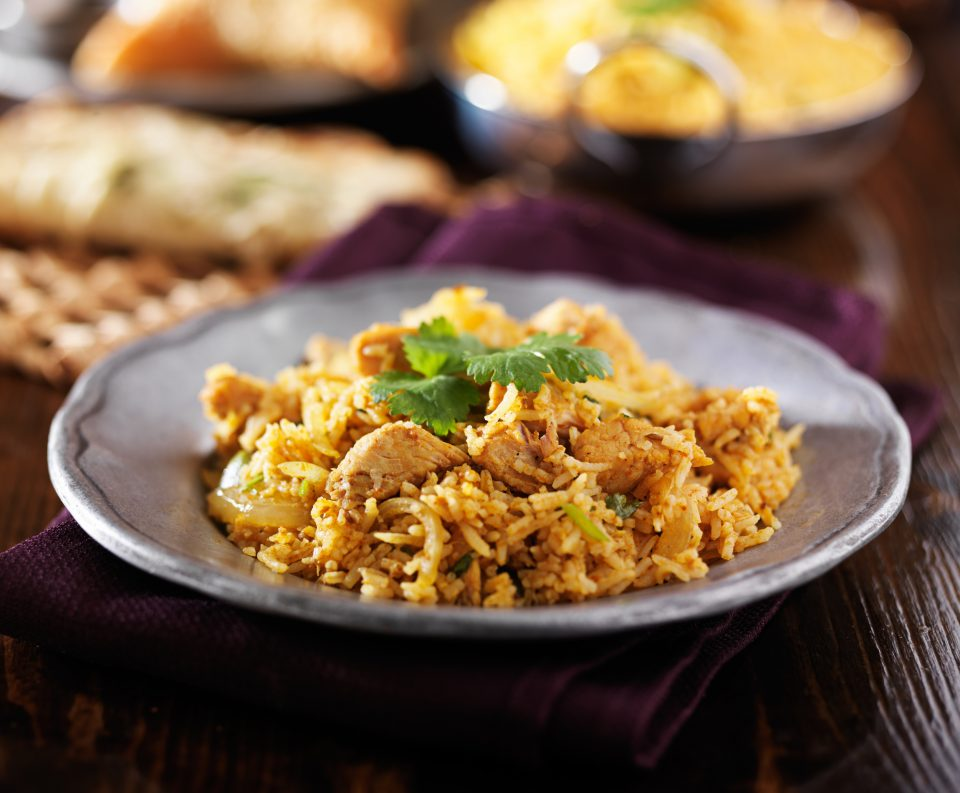 Get South Asian cuisine Indian recipe for chicken biryani and spiced saffron rice.