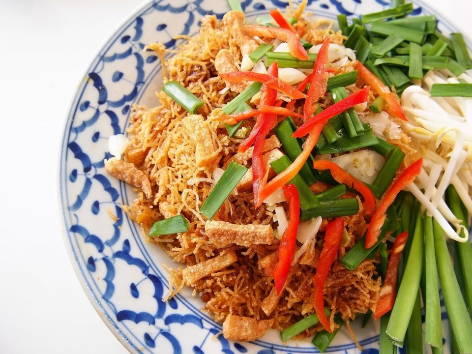 Get Southeast Asian cuisine Thai recipe for mee krob crispy rice noodles with tofu, kaffir lime, Thai chilies and veggies.